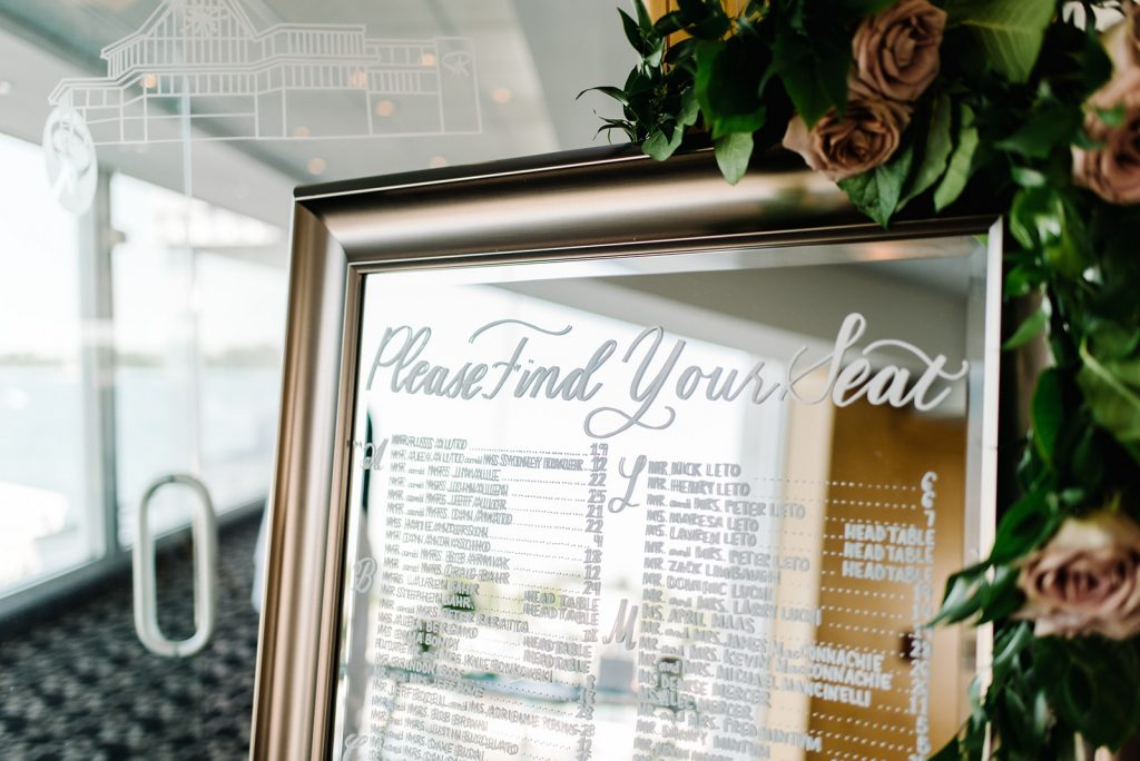 Seating chart sign on mirror