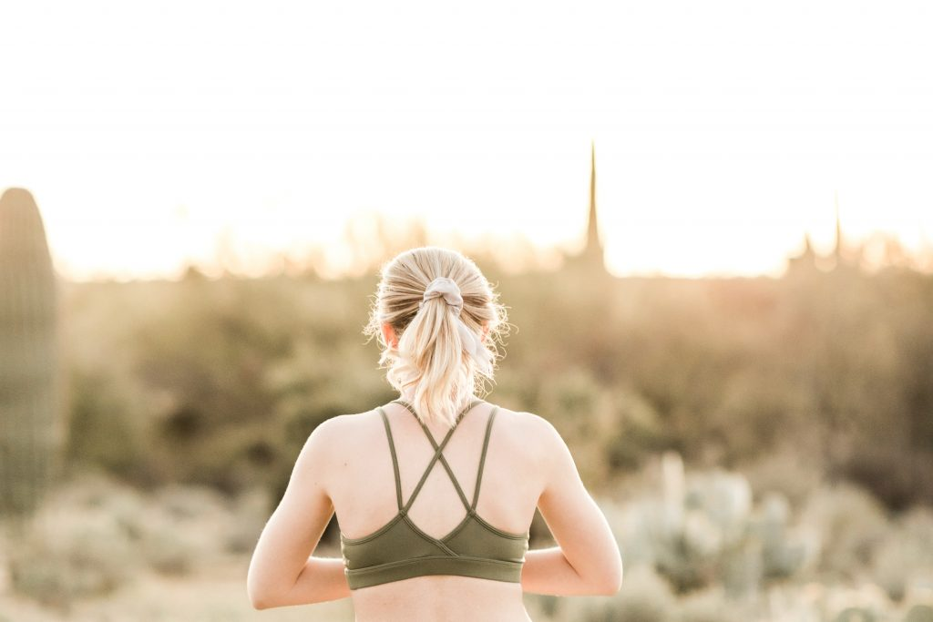 Woman in desert working out
